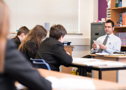 Teach First teacher at the front of the classroom addressing pupils