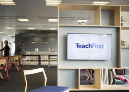 A Teach First logo on a tv screen
