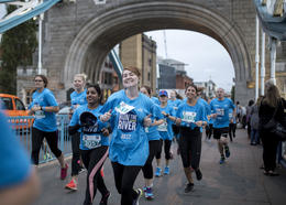 Run the River participants cross Tower Bridge, London