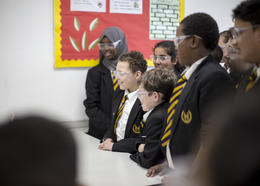 A group of pupils watch a science demonstration