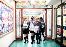 Students walk down a hallway