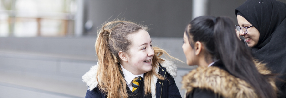 Pupils chatting in school