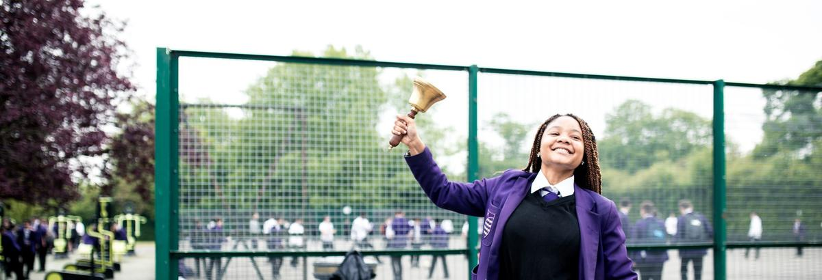 A pupil rings a bell