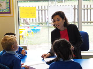 Headteacher talking to pupils