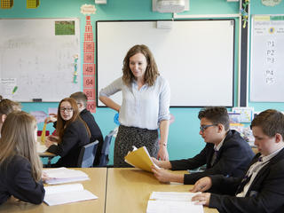 Teacher and pupils at Beaumont Leys school