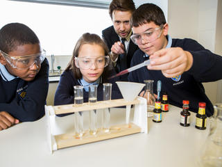 Pupils looking at test tubes