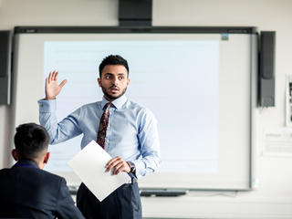 Male teacher teaching a class