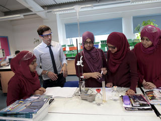 Teacher and pupils at science lesson