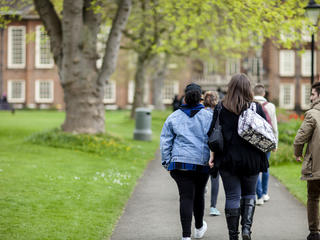 A group of campus reps walking through university grounds