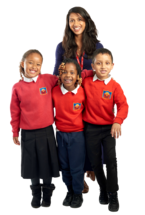 A Teach First trainee with three primary pupils, smiling to camera.