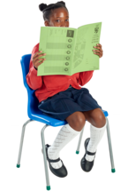 A seated schoolgirl peeks at the camera from behind an open exercise book.