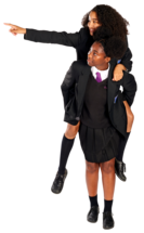 Two secondary school girls give each other a piggyback